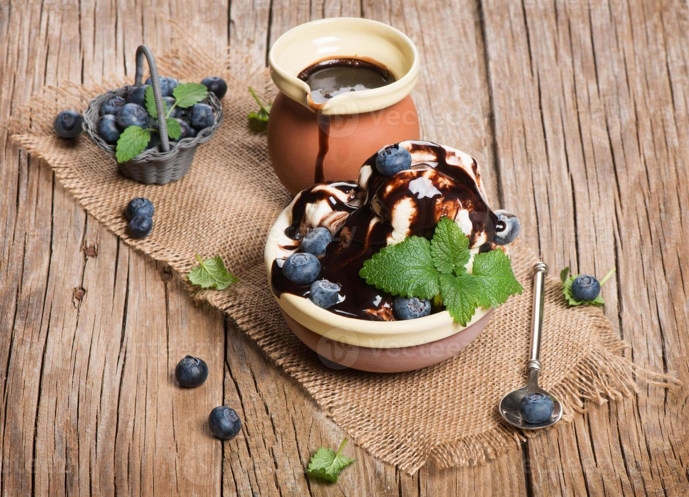 ice cream with berries on wooden background photo