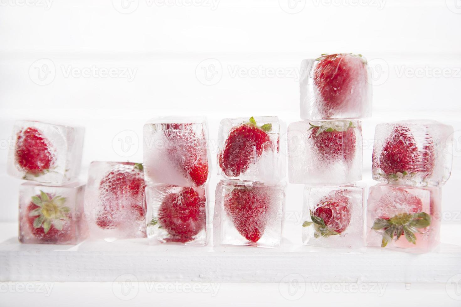 Ice cubes with strawberries photo