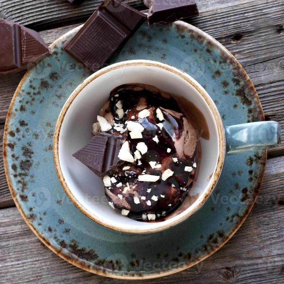 Ice cream with chocolate sauce photo