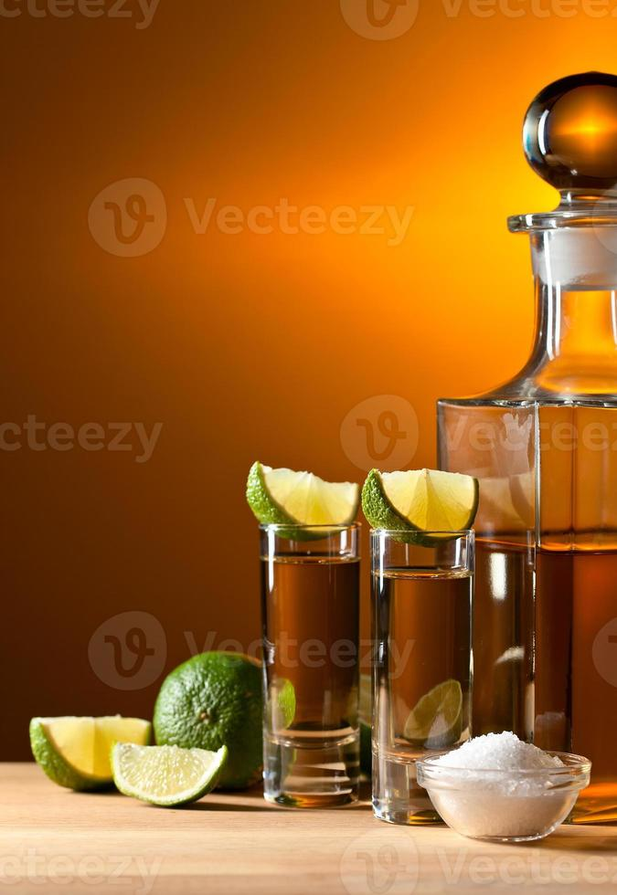 gold tequila with salt and lime photo