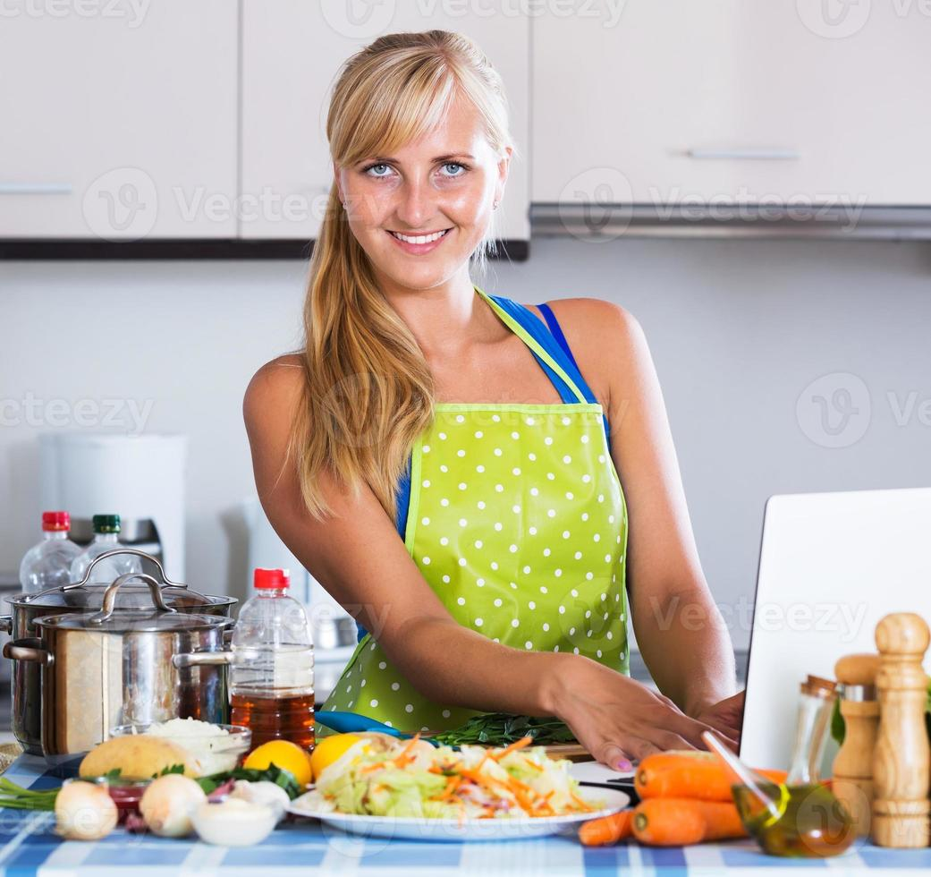 Woman searching recipe in internet photo