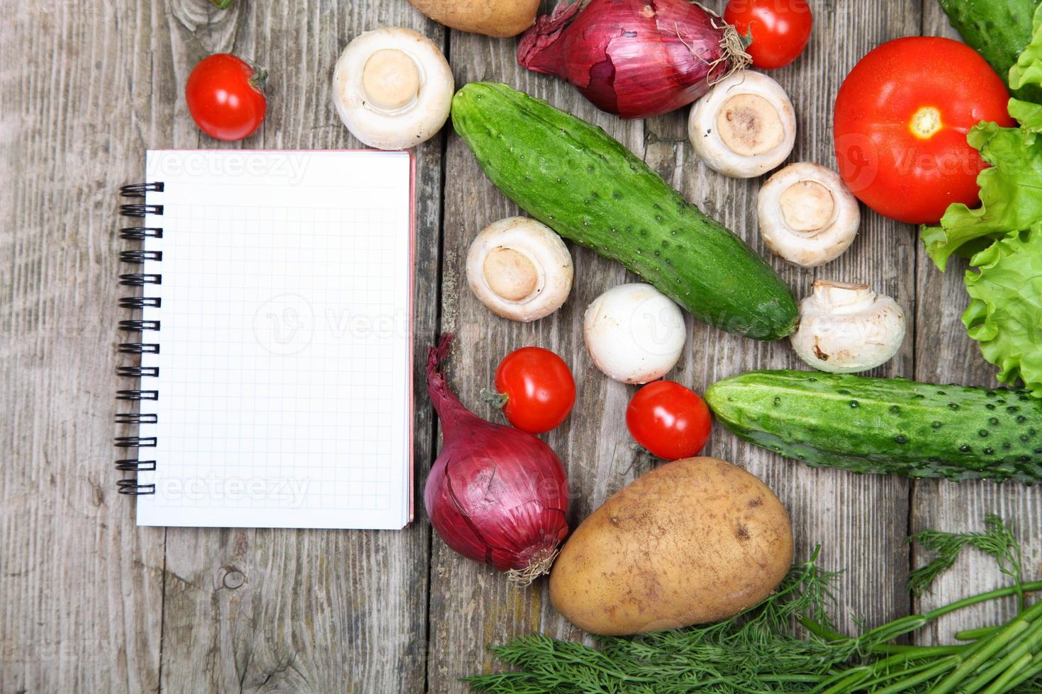 Fresh vegetables and paper for recipe photo