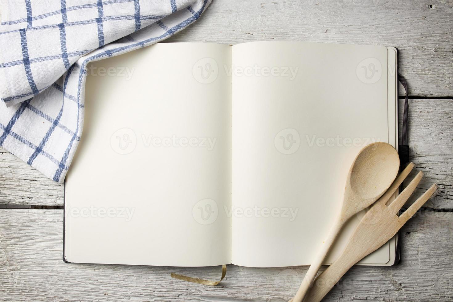 Blank recipe book on wooden table photo