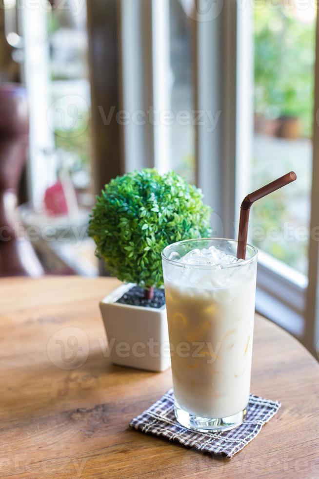 Hazelnut milk on wooden table photo
