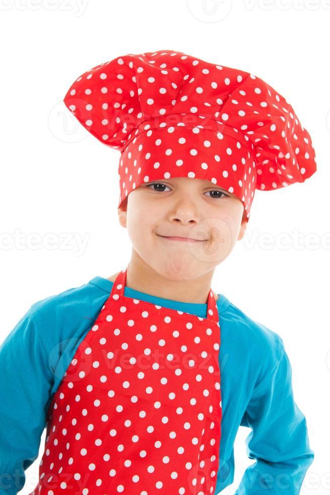 Retrato de estudio boy como pequeño cocinero foto
