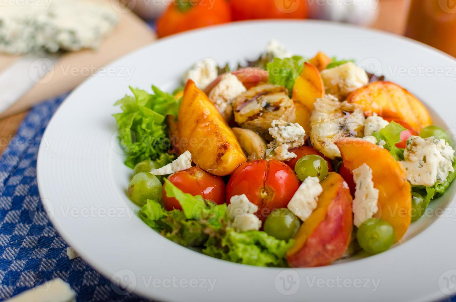 Grilled fruit with blue cheese and salad photo