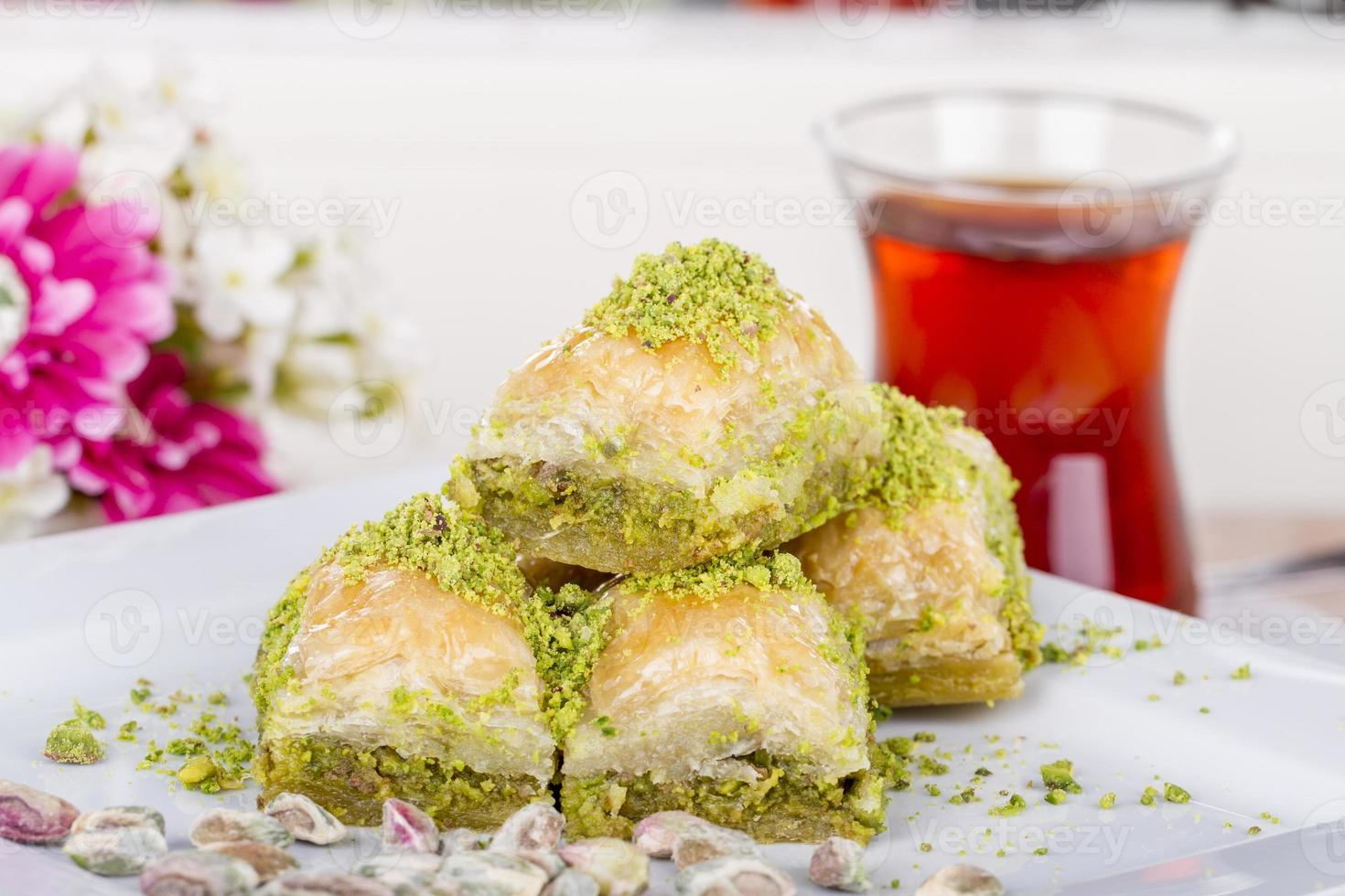 Traditional Turkish Arabic Dessert - Baklava with Honey and Nuts photo