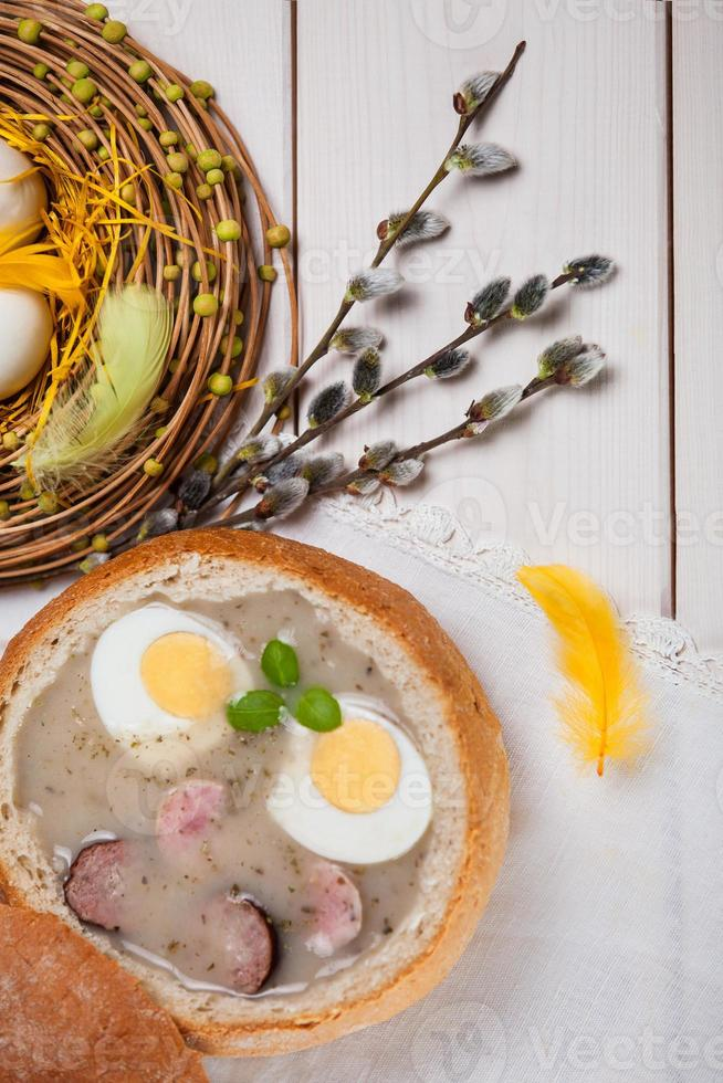 Spring decoration with white borscht on table photo
