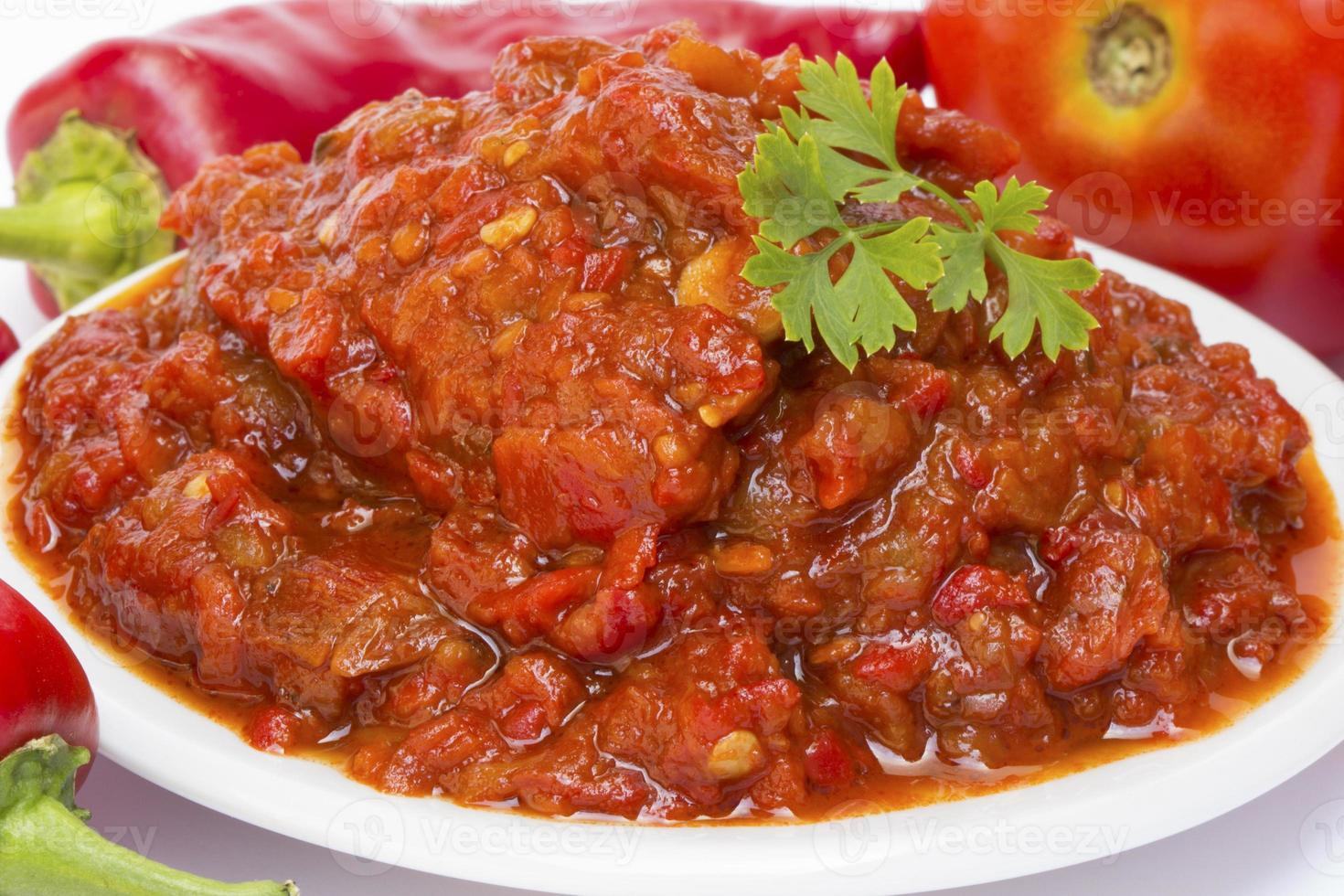 Chutney of tomatoes with peppers photo