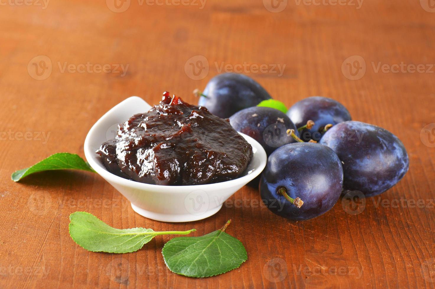 Bowl of homemade plum jam photo