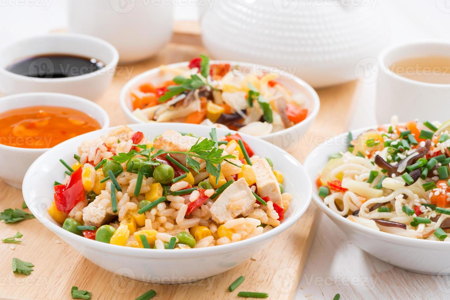 Asian lunch - fried rice with tofu, noodles, vegetables photo