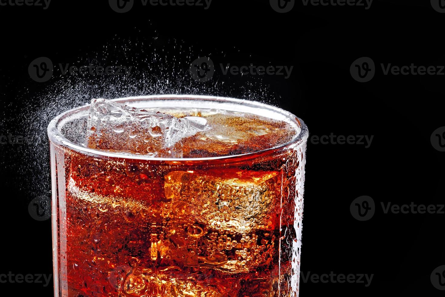 Glass of cold cola photo