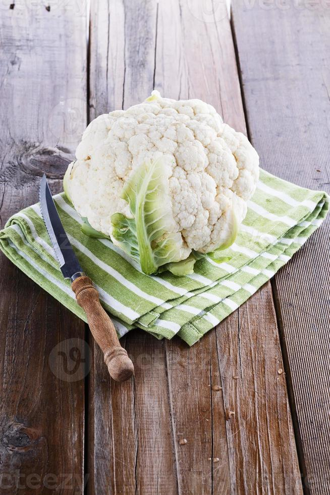 Single cauliflower d on a wooden background photo
