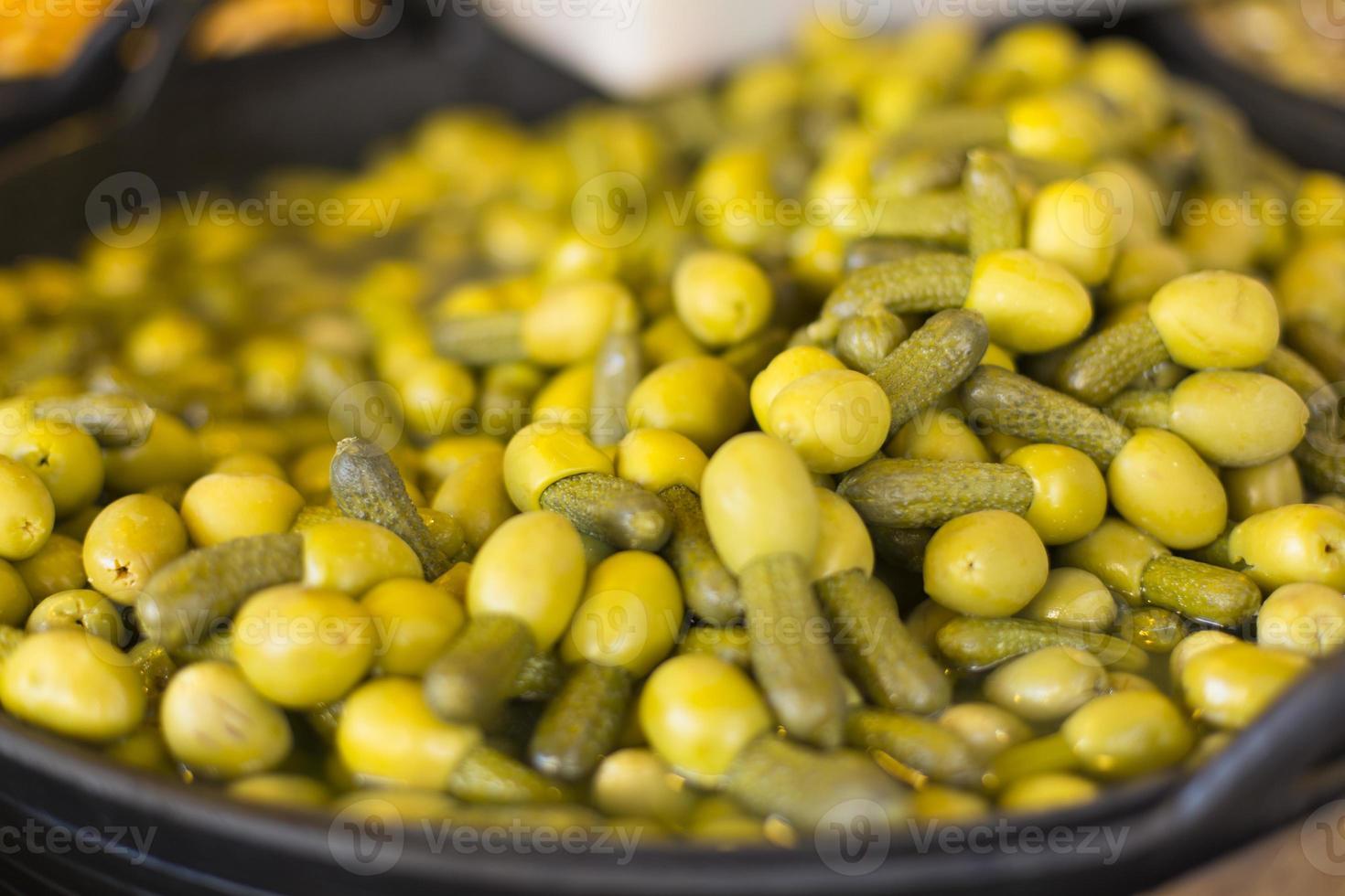 Olives filled with pickled gherkins photo