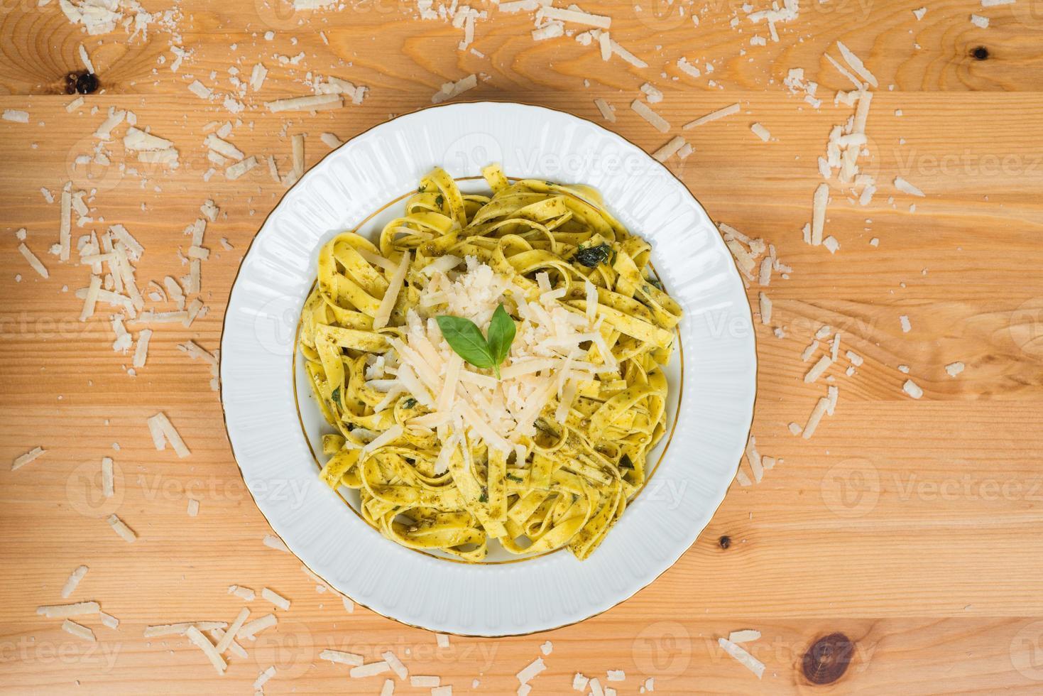 Tagliatelle pasta with pesto sauce photo