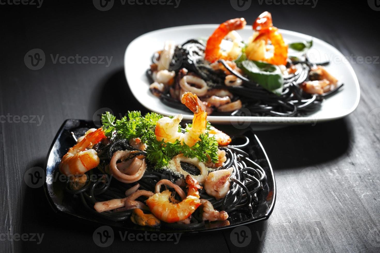Black spaghetti with seafood photo