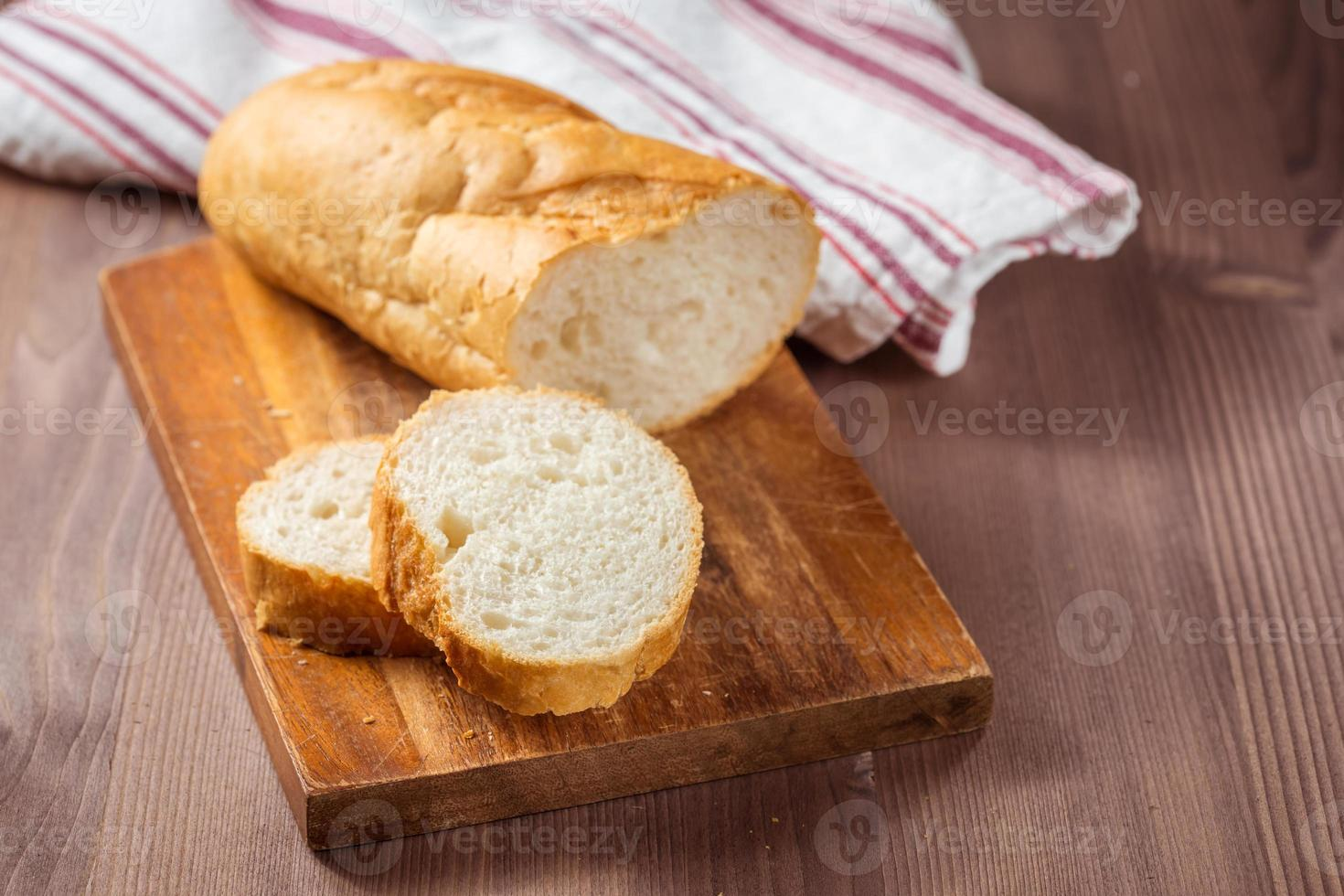 sliced bread on wooden table photo