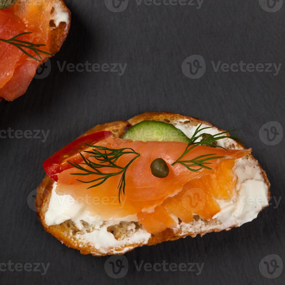 Finger food canape with smoked salmon photo
