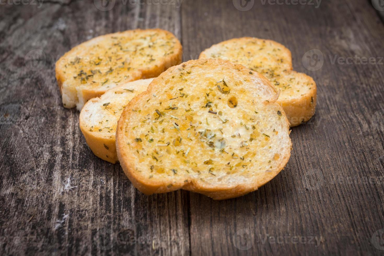Garlic bread on old wood photo