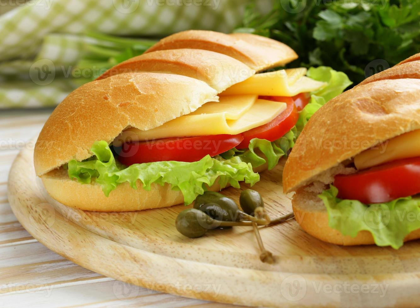 Fresh sandwich with vegetables, green salad and cheese photo