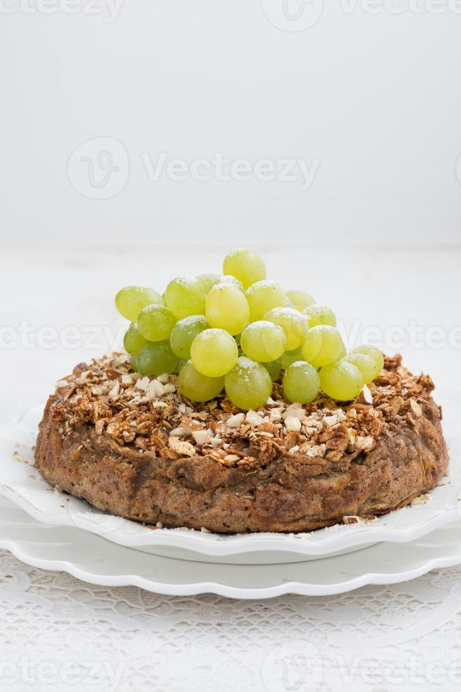 whole nut pie with grapes, vertical photo