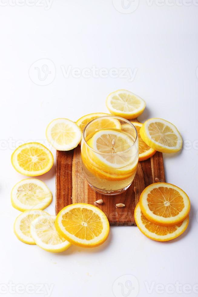 drink and stack of citrus fruits slices. photo
