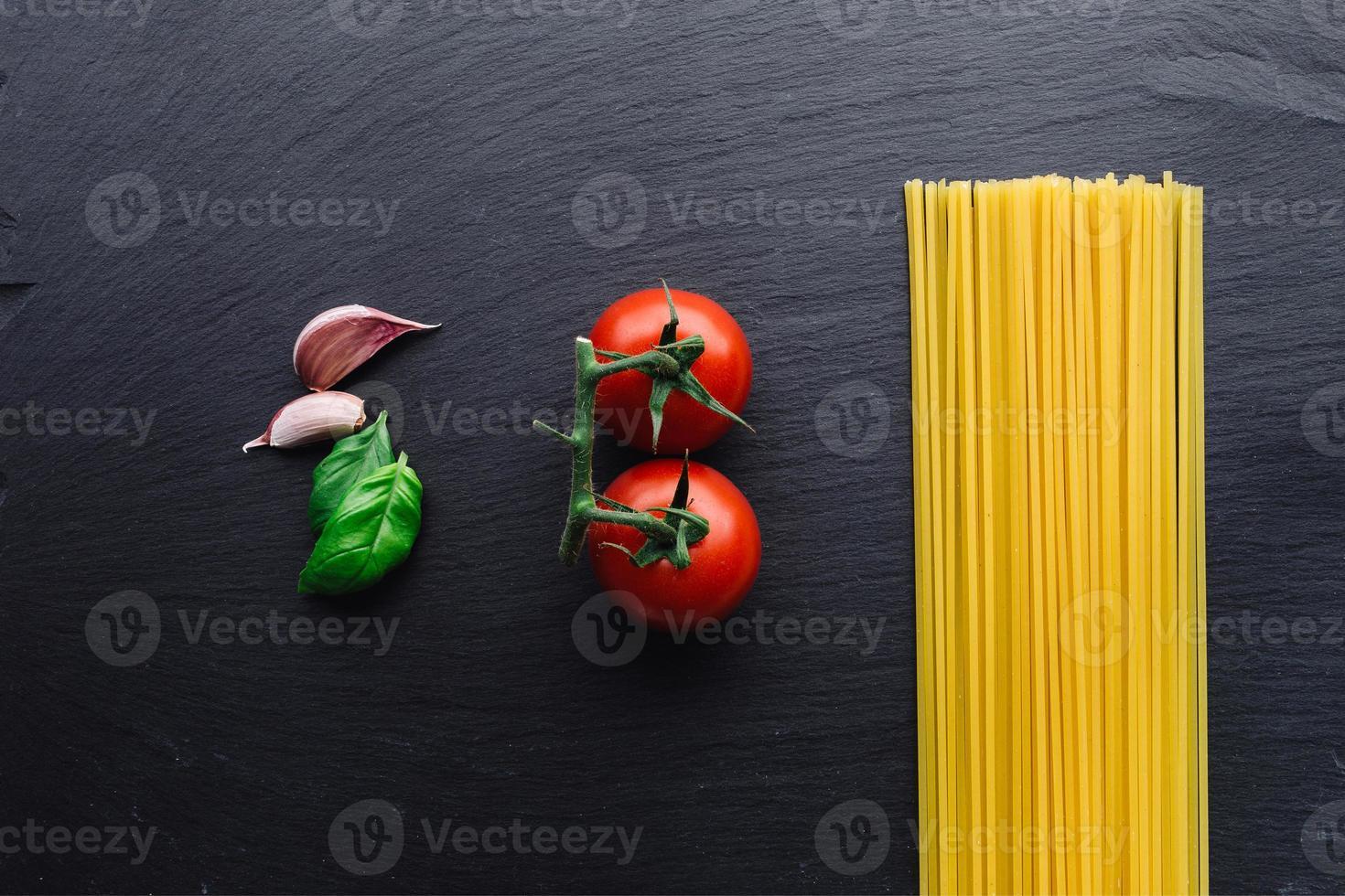 Pasta ingredients on black photo