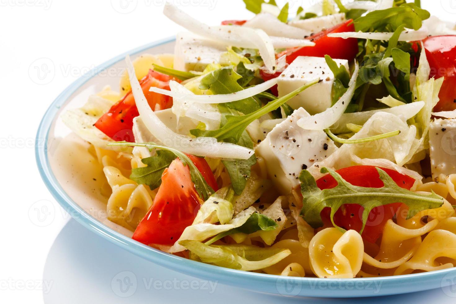 Pasta with feta and vegetables photo
