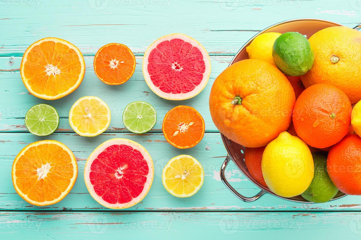 Citrus fruits in retro colander. photo