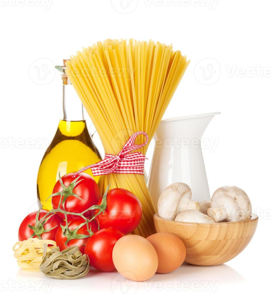 Pasta, tomatoes, eggs, mushrooms and olive oil photo