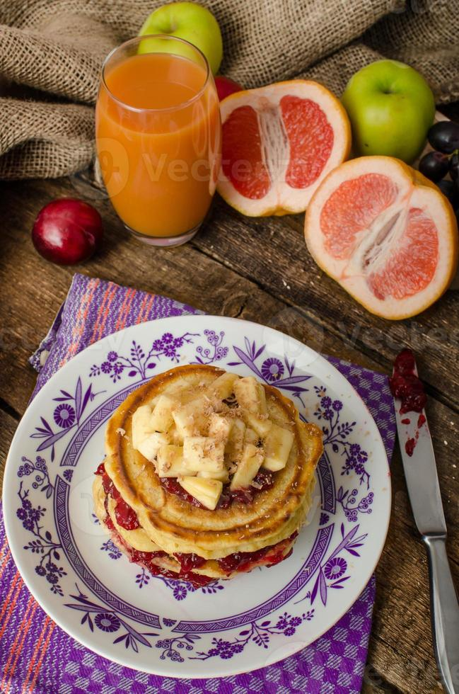 Homemade pancakes with bananas photo
