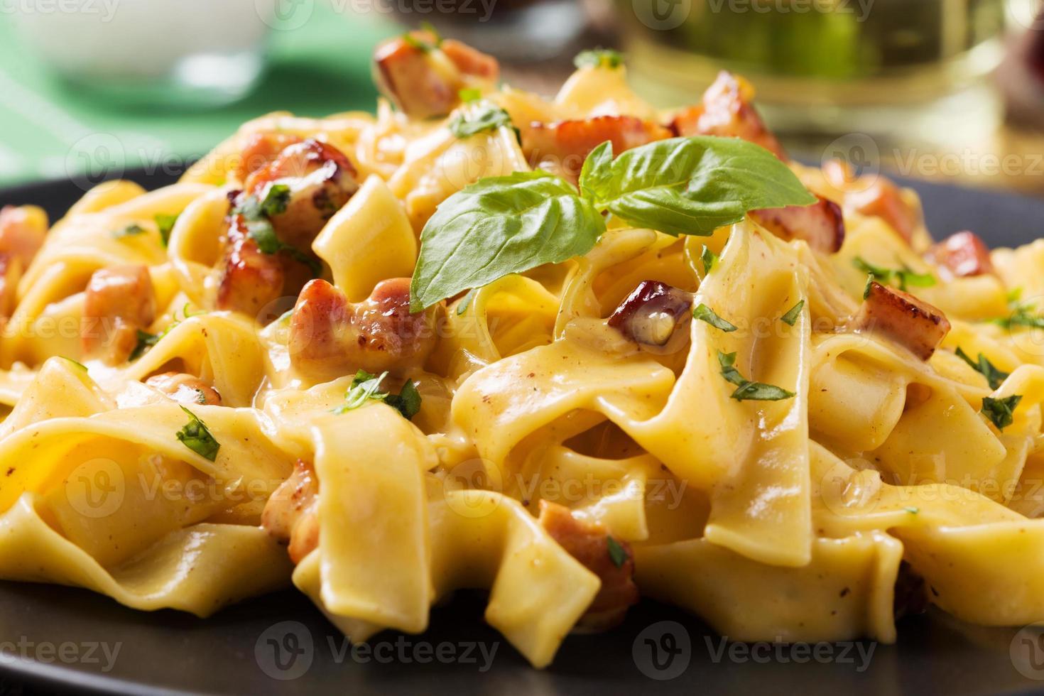 Pasta Carbonara with bacon, basil and cheese photo