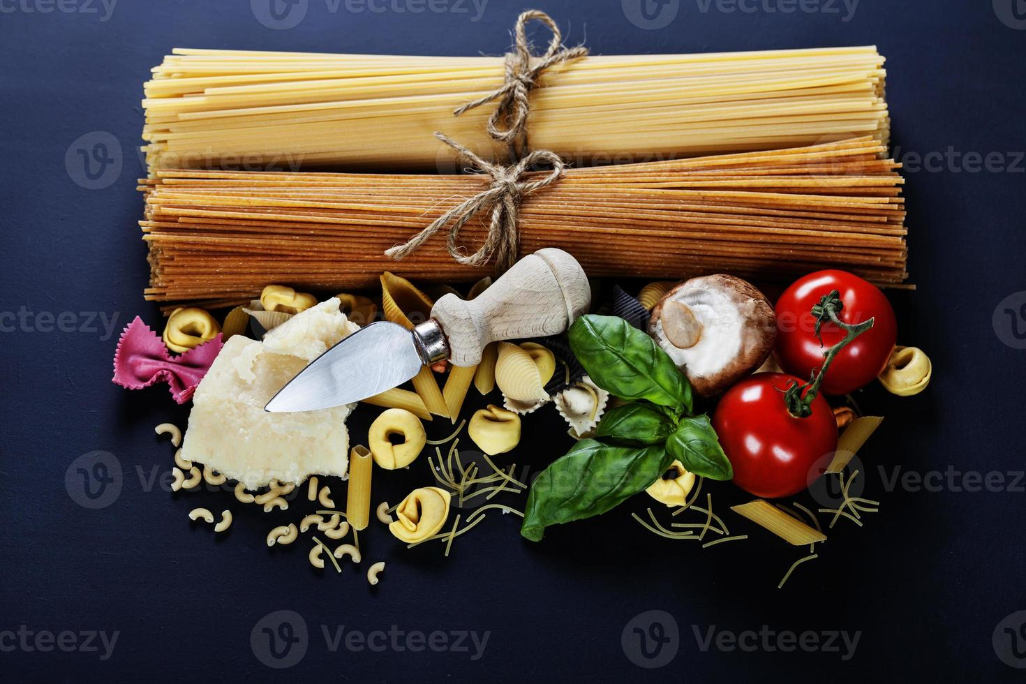 Italian ingredients - pasta, vegetables, spices, cheese photo