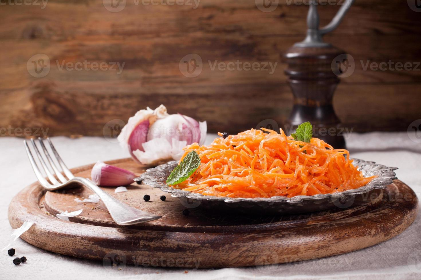 Spicy Korean style carrot salad on metal plate photo