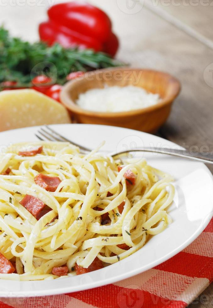 Pasta carbonara on the wooden table photo
