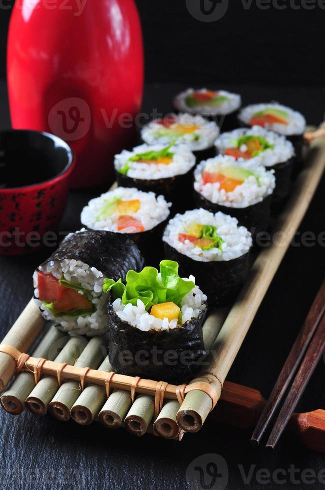 Vegetarian homemade sushi with avocado, tomato, peppers and lettuce. photo