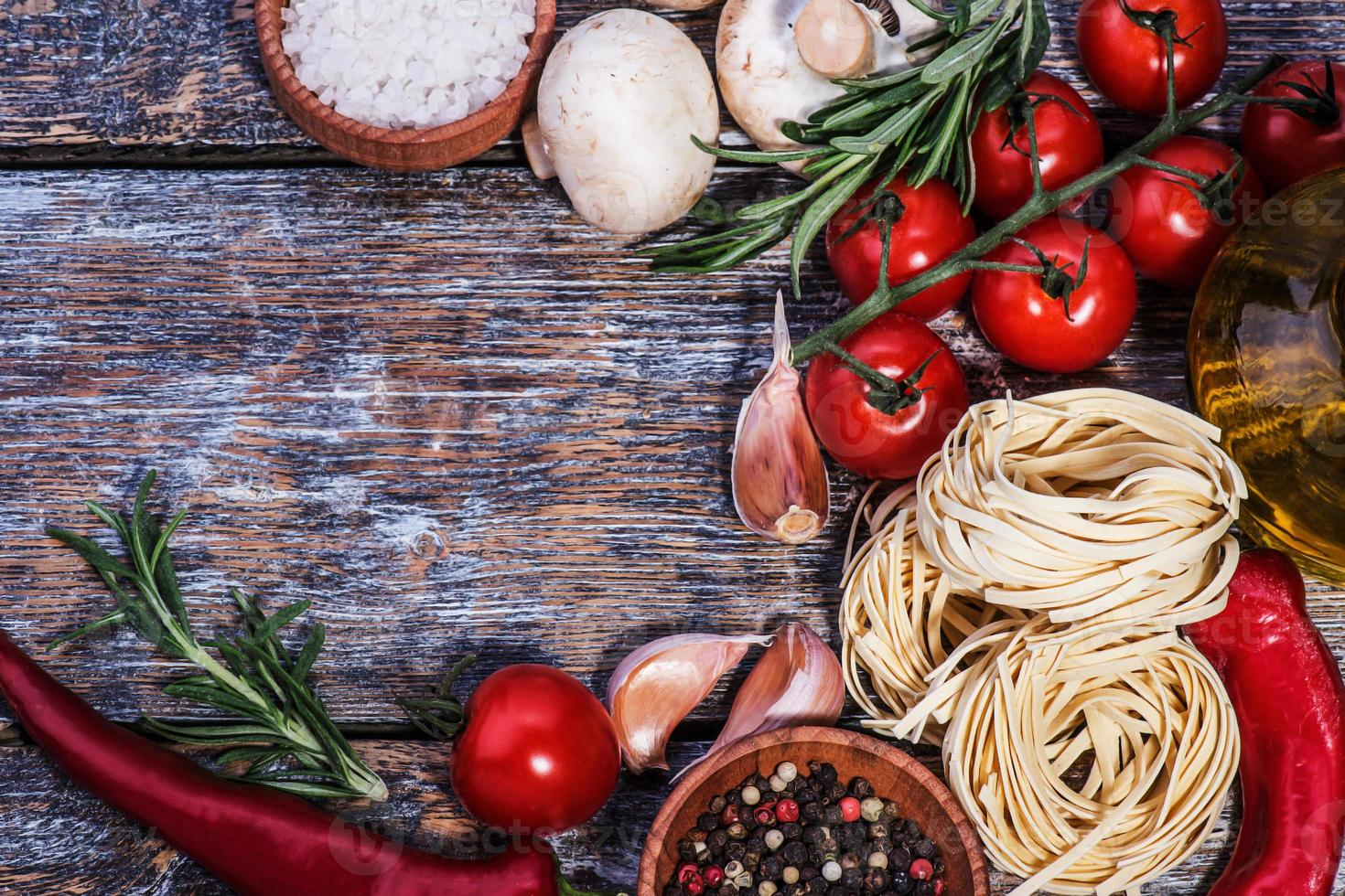 Ingredients for pasta on a wooden background photo