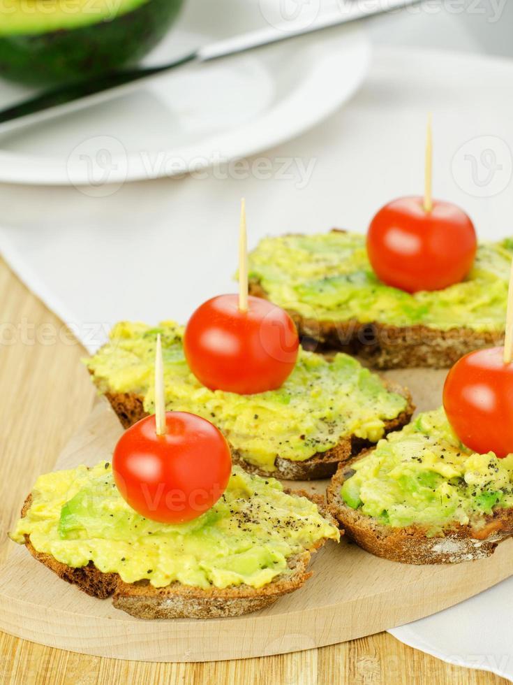 Avocado with tomato on bread photo