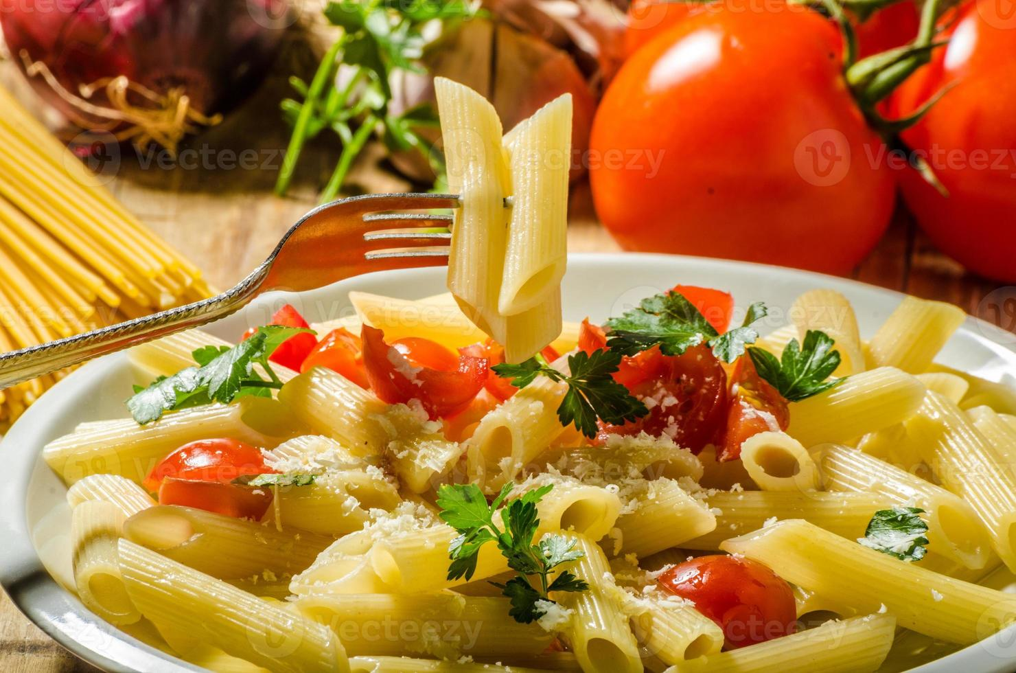 Delicious pasta with tomatoes photo