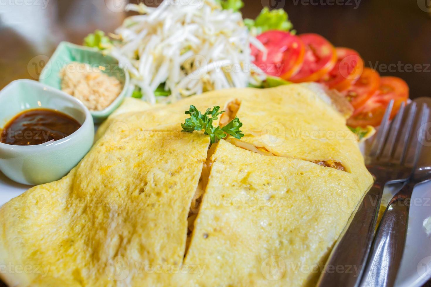 Pad Thai with fried egg wrapped Times photo