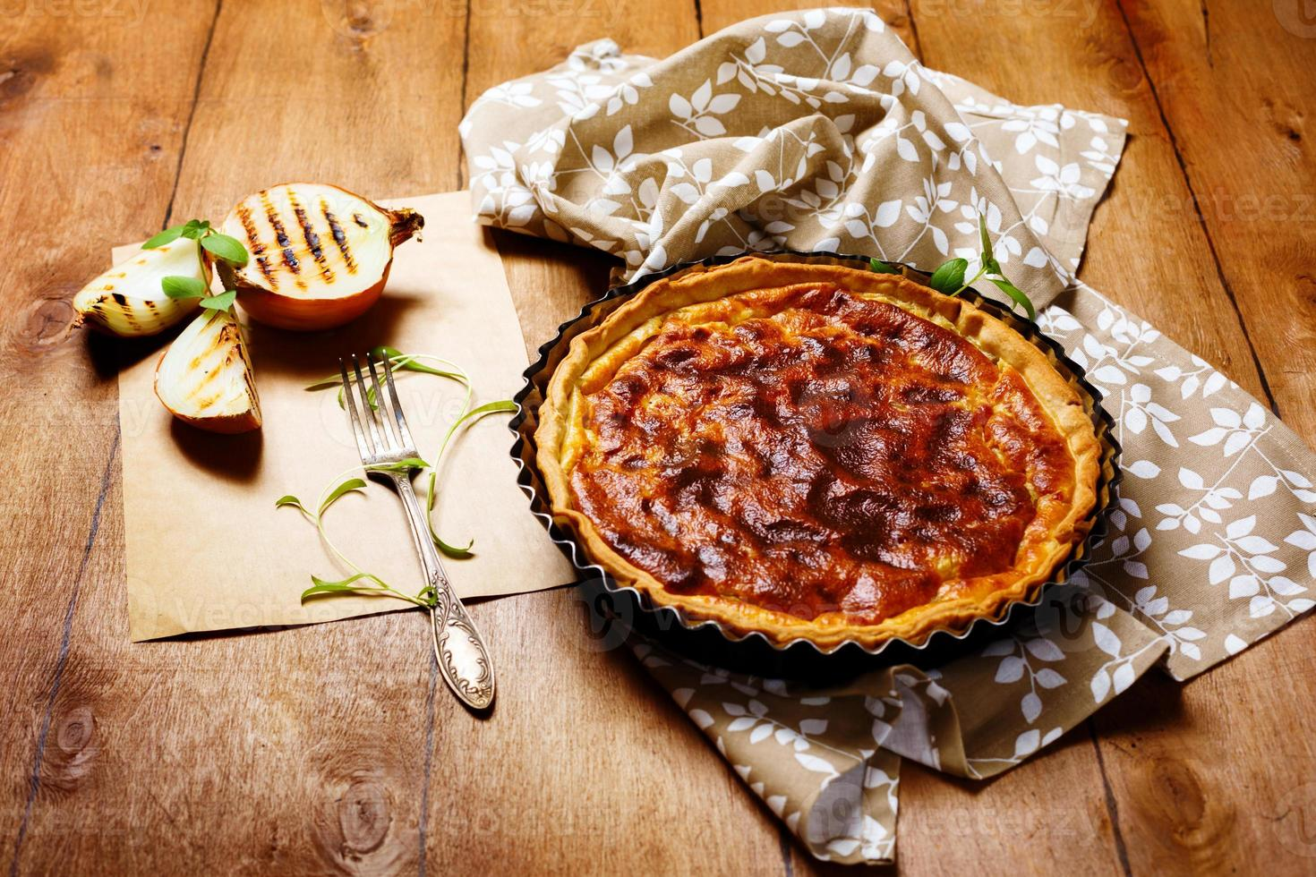 Onion pie or tart served with grilled onion photo