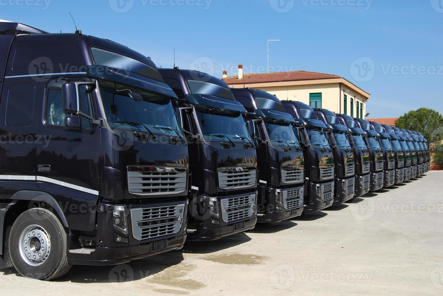 corporate fleet trucks lined photo
