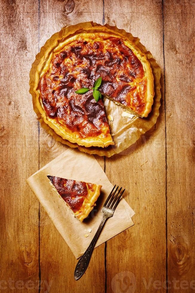 Appetizing tart served with fresh herbs photo