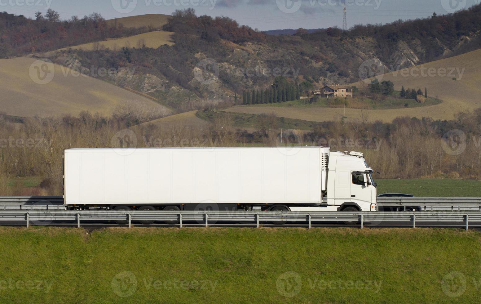 white truck on highway photo