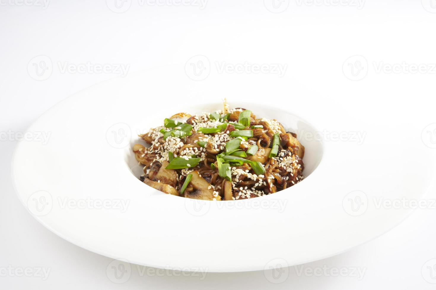 Bowl of stir fried udon noodles with mushrooms photo
