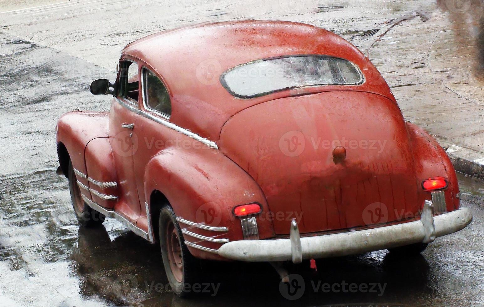 Beautiful Old Red Classic Car On The Road photo