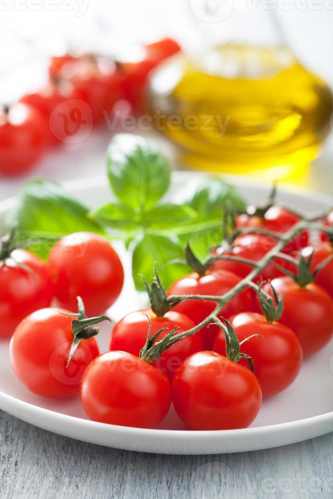 cherry tomatoes and basil photo