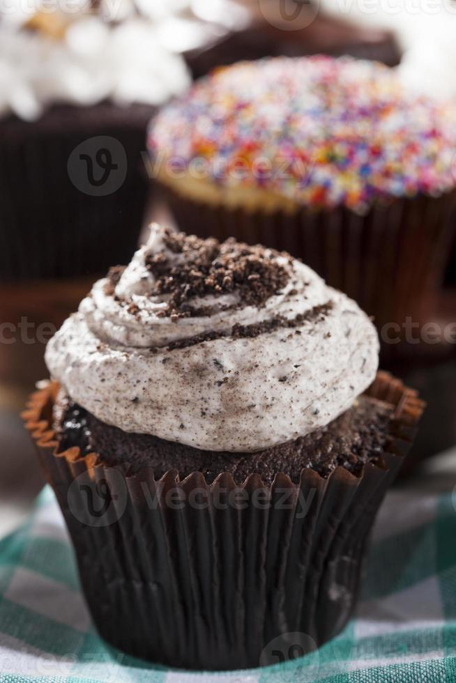 Assorted Fancy Gourmet Cupcakes with Frosting photo