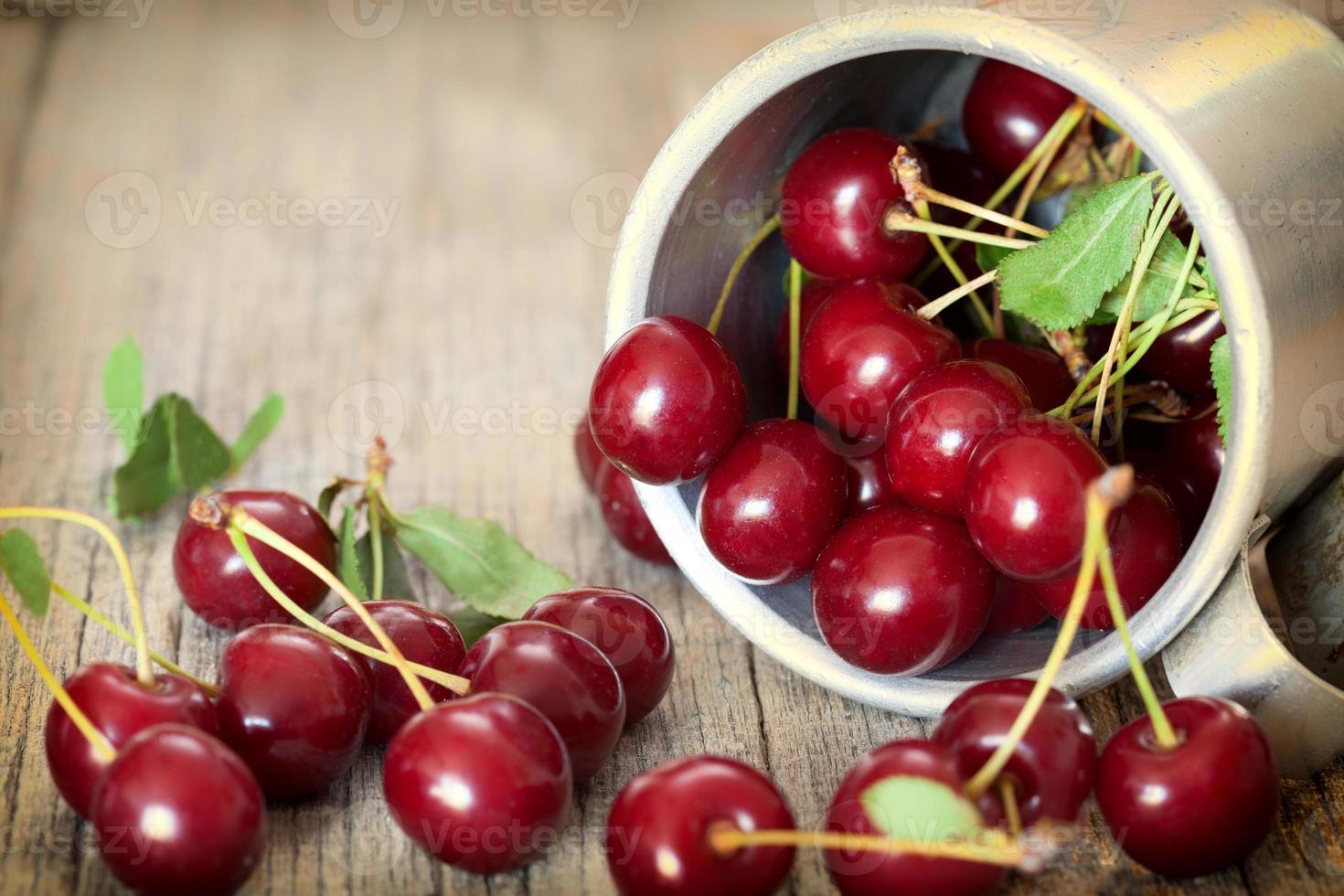 Sweet cherries  in a vintage bowl photo