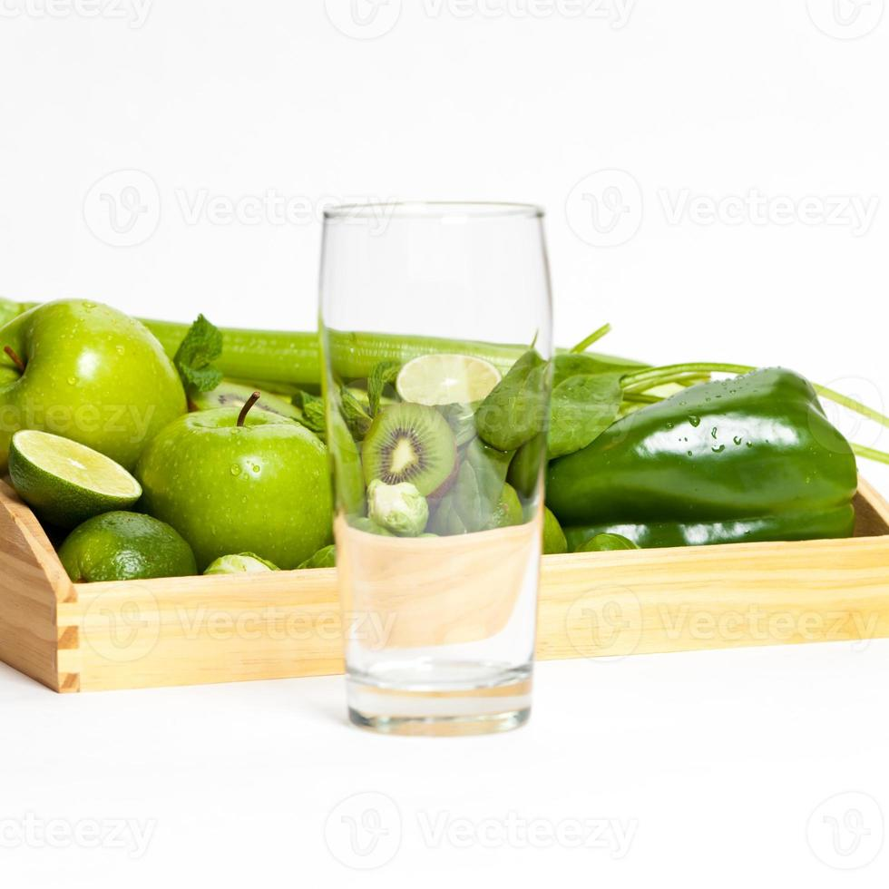 Fresh green vegetables and glass photo
